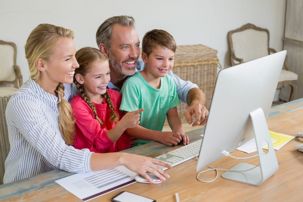 Family using computer at home